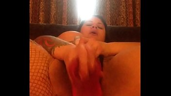 Ripping my fishnets to get to my throbbing pussy