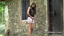 Cute teens spreading legs and pissing outdoor