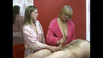 Senior masseuse helps j. masseuse in jerking off a naked client