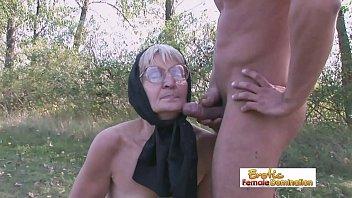 Granny in black stockings fucks a stud on the field