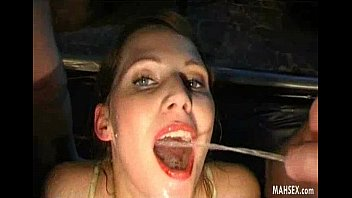 Brunette girl in lingerie gives swallowing pissing