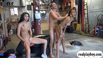 Skinny babe sucks off and gets pounded in car garage