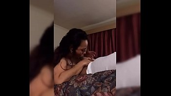 LATINA MILF SUCKING ME WHILE TALKING TO HER HUSAND ON THE PHONE
