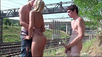 A guy is jerking on his best friend girlfriend in PUBLIC by a railway