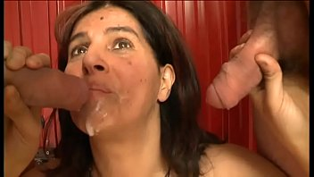 Amateur whore sucking two cocks