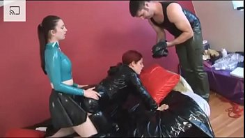 Slave gets fucked in a heavy latex and b.