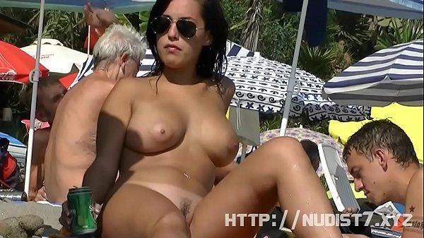 Sexy nudist  chicks are captured on camera on a beach
