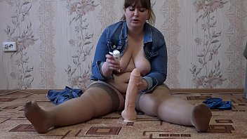 A fat girl with a big ass masturbates her pussy and jumps on a rubber penis