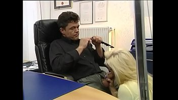 Sexy blonde gives a blow job under the desk of her boss