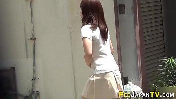 Asian teenagers urinate
