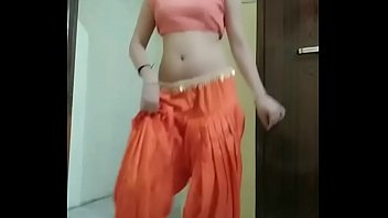 Indian girl Nidhi doing belly dance at home