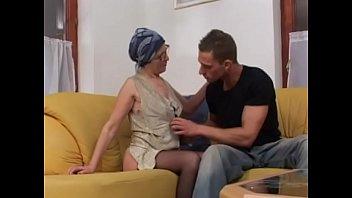 Mature brunette enjoys a huge cock