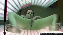 Luxury Busty brunette masturbates in solarium