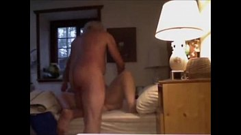 Grandpa 50s, picking up grandma in bed