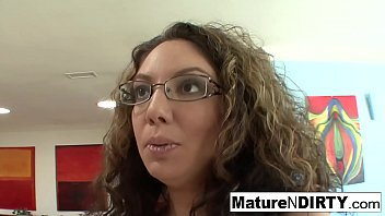 Brunette MILF in glasses seduces her nephew on the couch 7 min