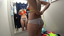 Mature milf and her young daughter in a public fitting room. Different swimsuits and mini bikinis on sexy big ass.