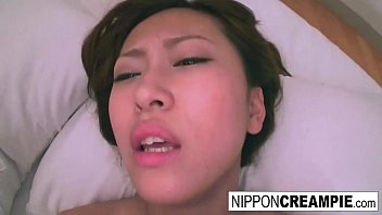 Japanese couple record themselves fucking in a hotel room