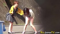 Uniformed asian worker wets herself