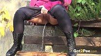 Brunette Hottie Takes Huge Long Piss On Bench In Public