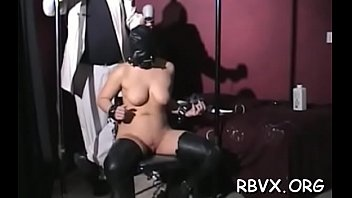 Engaging maid inserts a fake penis in her tight pussy