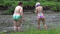 Lesbians with big asses try body art outdoors. An amateur fetish of nudist girlfriends on the river bank.