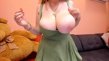 Hot redhead with giant boobs