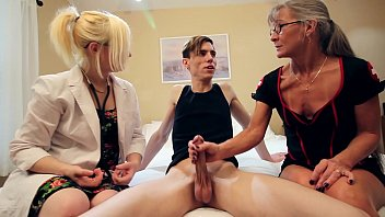 2 Nurses Give Their Patient a Double Handjob