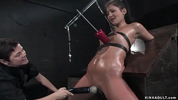 Bound oiled slave is whipped