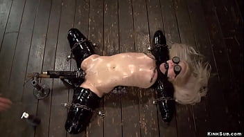 Blonde with limbs in latex is chained 5 min
