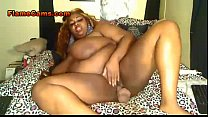 Ebony BBW amateur with huge tits fills her pussy with a toy