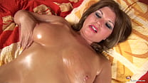 mom plays with her oiled massive boobs