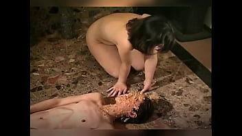 Boy face covered with Japanese woman puke