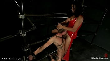 Shemale in latex fucks chained man