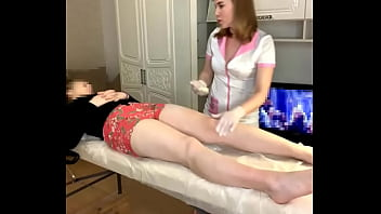 Legs waxing lesson for a young and beautiful pussy