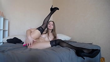 stockings, shoes and cigaette, shows boobs wearing black bodysuit