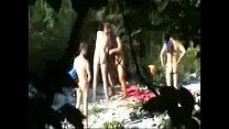 Horny granny having fun with y. men at nude beach