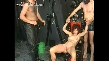 Naked milf slave gets hot candle wax over her boobs and is spanked on her pussy by masked master S43