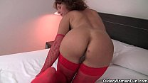 Hot granny in stockings rubs her hairy pussy