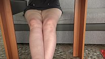 A hidden camera under the table spies on plump legs and peeks under the skirt while a mature housewife drinks tea. Amateur foot fetish.