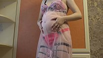 Milf during pregnancy makes measurements of the growing tummy and boobs, and then masturbates a big pussy.