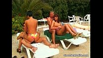 Group sex relaxation by the pool for two