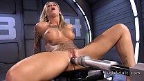 Inked busty blonde fucking machine