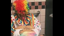 Girl rides clown in bathroom stall