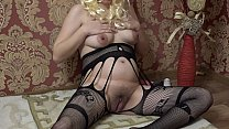 Pregnant milf in a sexy costume shakes natural tits and with a dildo fucks hairy pussy.