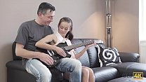 OLD4K. Young lassie makes some noise with old bass-guitar player