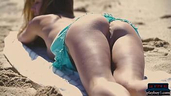 Petite body MILF Lily Chey suntanning on the beach