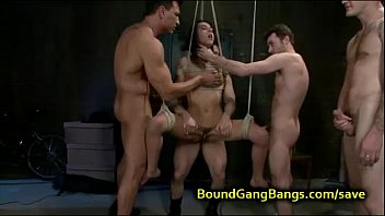 Tied up babe suspended orgy fucked