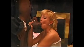 Nasty fairhaired housewife Kiss in white lingerie is fond of playing  big black flute and swallowing the music
