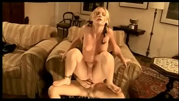 Busty blonde Gen Padova gets banged from behind on the couch