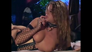 Sex in a corset black boots and fishnet stockings